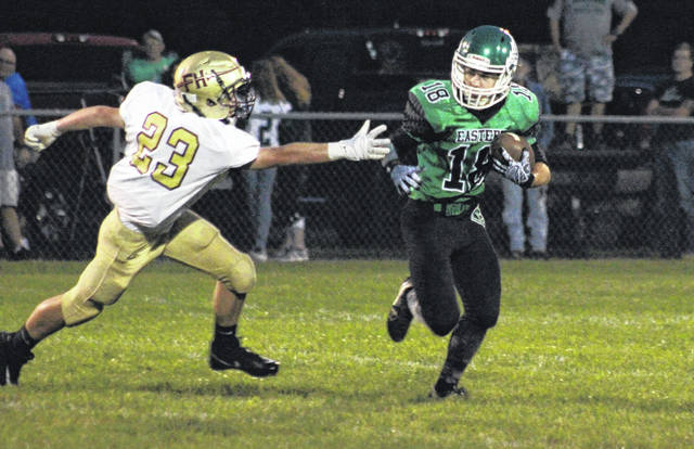 Eastern junior Sharp Facmyer (18) slips past a Federal Hocking defender during the Eagles' win on Sept. 15 in Tuppers Plains, Ohio.