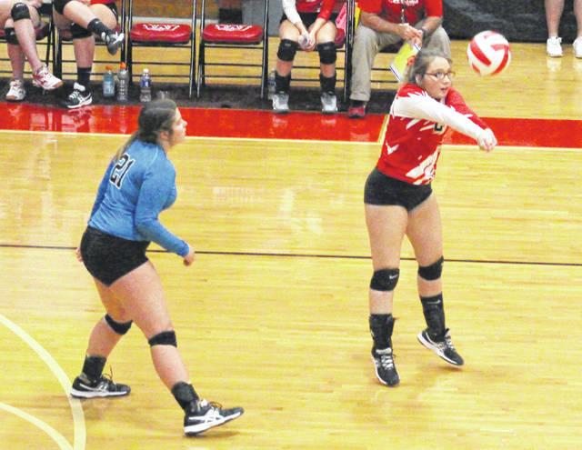 Wahama senior Destiny Sayre bumps a ball in the air during Game 2 of Wednesday night's non-conference volleyball match against Hannan in Mason, W.Va.