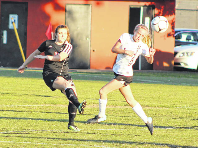 Point Pleasant senior Alex Warden, left, clears the ball away from a Nitro attacker during the first half of a Class AA-A Region 4, Section 1 championship match in Nitro, W.Va.