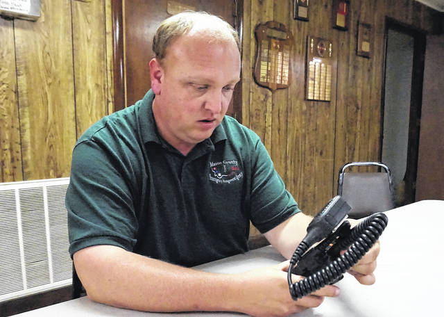 R.C. Faulk, Deputy Director of Mason County 911 and a member of the Mason Volunteer Fire Department (MVFD), is pictured as he programs one of 10 digital handheld radios recently purchased by the MVFD. The Bend Area organization is the first fire department in the county to enter the world of digital communication.