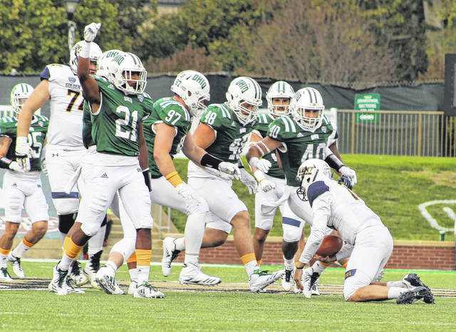 Ohio cornerback Jalen Fox (21) celebrates a sack of Kent State quarterback Dustin Crum, right, during the third quarter of Saturday's Mid-American Conference football game at Peden Stadium in Athens, Ohio.