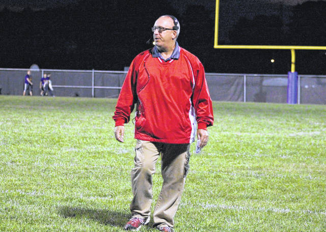 Wahama head coach Dave Barr walks on the field during a break in the action, in the White Falcons' double-overtime loss on Sept. 8 in Racine, Ohio.