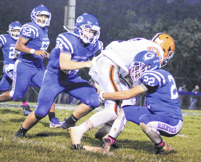 Gallia Academy senior Tanner Allen wraps up an Ironton defender as teammate Cade Roberts (34) gives chase during a Week 9 football contest in Gallipolis, Ohio.
