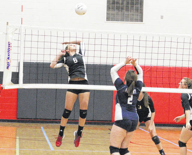 Point Pleasant sophomore Sami Saunders (6) goes up for a spike attempt during Game 2 of Tuesday night's volleyball match against Hannan in Point Pleasant, W.Va.