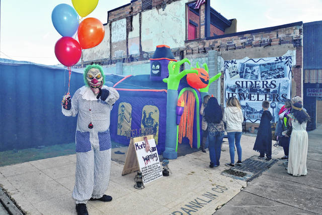 """The lines were long and the screams were loud on Thursday night for those who experienced Morbid Manor, a haunted maze geared towards teens. The attraction was sponsored by the Get To The Point group and was set up on the lot where the old Franklin building once stood. Pictured is a """"friendly"""" clown welcoming those into the manor."""