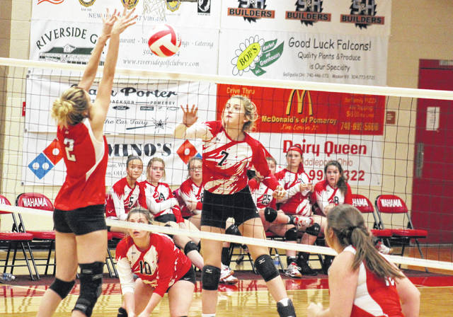 Wahama freshman Emma Gibbs (7) spikes the ball past a Ravenswood defender during the Lady Falcons' tri-match on Thursday in Mason, W.Va.