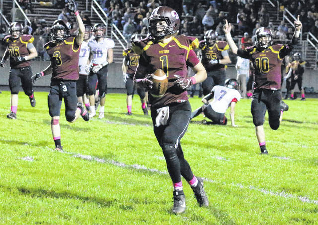 Meigs junior Zach Bartrum (1) strolls into the end zone for a touchdown during the first quarter of Friday night's TVC Ohio football contest against Alexander in Rocksprings, Ohio.