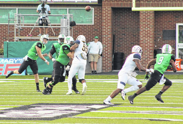 Marshall quarterback Chase Litton, left, tosses a pass out to receiver Marcel Williams (9) during a Sept. 16 football game against Kent State at Joan C. Edwards Stadium in Huntington, W.Va.