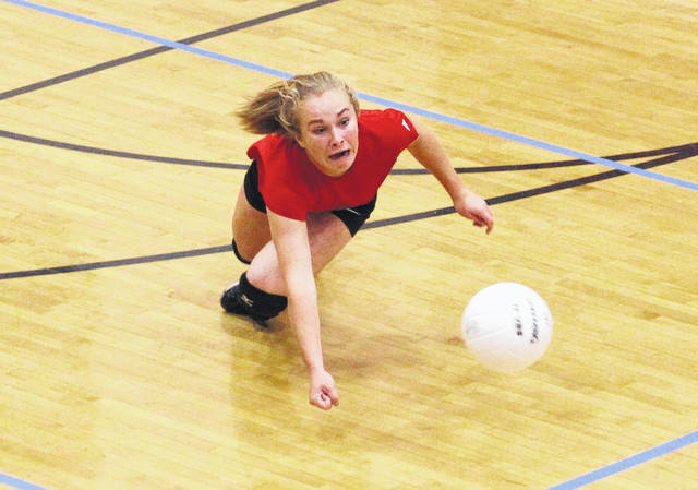 Point Pleasant sophomore Peyton Jordan dives for a dig attempt during Game 1 of Thursday night's non-conference volleyball match against Winfield in Point Pleasant, W.Va.