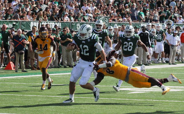 Ohio sophomore Nathan Rourke (12) slips through the grasp of a Malik Fountain (8) for a touchdown run on Saturday in Athens, Ohio. (Alex Hawley|OVP Sports)