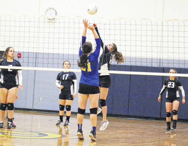 Hannan senior Hailey White tips a ball over the net during Monday night's Class A Region IV, Section 2 volleyball match against Van at Buffalo High School in Buffalo, W.Va.