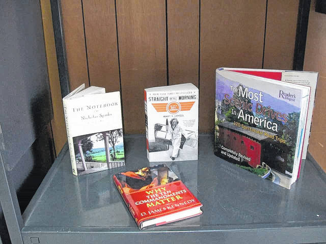 Purposeful Reading Chairperson Mary Sue Kincaid set up a display of books taken from the CEOS Library.