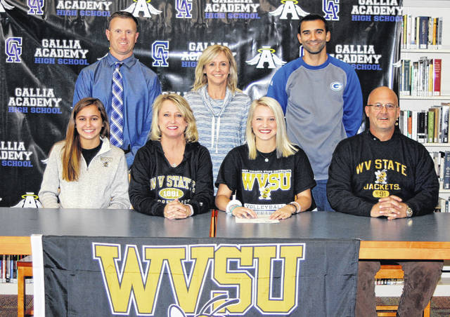On Wednesday at Gallia Academy High School, senior Grace Martin signed her National Letter of Intent to join the West Virginia State University volleyball team. Sitting in front row, from left, are Peri Martin, Leanna Martin, Grace Martin, and Rick Martin. Standing in the back row are GAHS Athletic Director Adam Clark, Blue Angels head coach Janice Rosier, and strength and training coach Joshua Perry.
