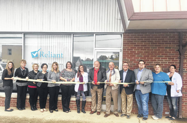 Reliant Drug Test Solutions, located at 703 22nd Street, Point Pleasant, recently hosted a ribbon cutting. Pictured in attendance are, from left, City Clerk Amber Tatterson, Teresa Stapleton, Coria Kent, Hilda Austin from the Mason County Area Chamber of Commerce, Jody DeWees, Cathy Crabtree the general manager, Heaven Wade, drug test coordinator, Larry Jones the chamber president, Mayor Brian Billings, Steve Patrick the owner, Todd Brammer, Sherry Barclay, Chris Noon. Phone 304-593-7881 for more information or find them on Facebook.