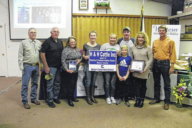 The 2017 Mason County Conservation Farm Winner is H&H Cattle, Inc. owned and operated by George, Eleanor, Joe, and Anna Hoffman. Pictured are members of the Hoffman family with their award.