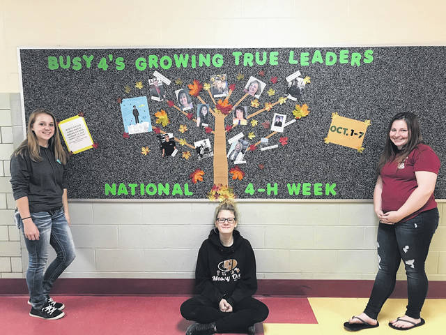 The Busy 4's 4-H Club began the new 4-H year by celebrating National 4-H Week. Members did a bulletin board at PPJ/SHS to encourage new membership. Members working on the bulletin board were Julia Parsons, Courtney Young and Aleah Gerwig.