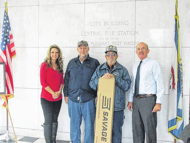 Donnie Hill of Leon, was the winner of the Krodel Splash Pad Savage Axis XP .270 Riffle Raffle, which was drawn at a recent Point Pleasant City Council meeting. Pictured are Clerk Amber Tatterson, Jerry Lanier owner Fat Daddy Firearms, Donnie Hill, and Mayor Brian Billings.