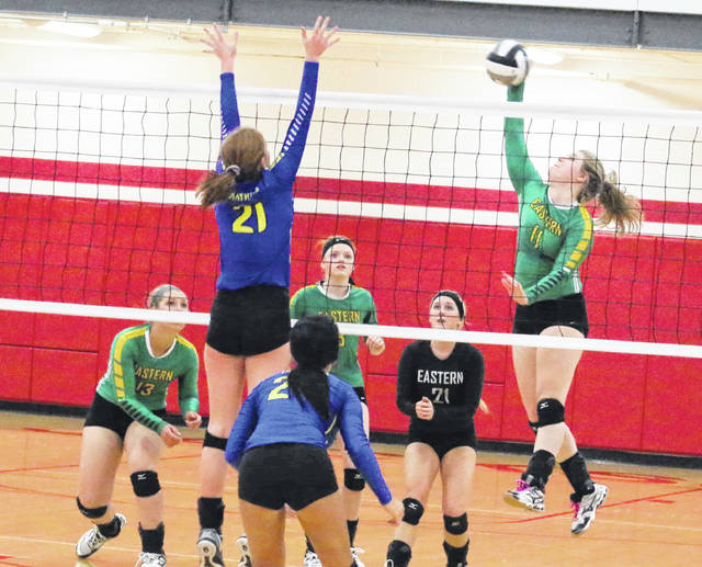 Eastern senior Mackenzie Brooks (11) hits a spike attempt during a Division IV district volleyball tournament match against Portsmouth Clay on Oct. 25 at Jackson High School in Jackson, Ohio.