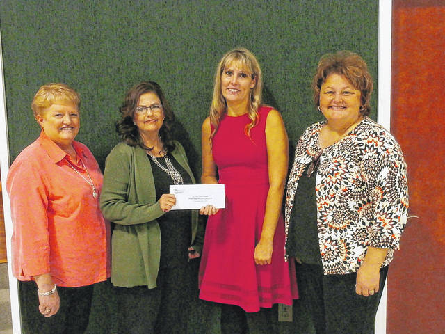 Christy Crowell, executive director of the Community Foundation of Mason County, presents the Mason County 4-H Leaders Association with $4,921 for the new 4-H dinning hall. Also pictured are Linda Roush, Lorrie Wright and Missy Deem.