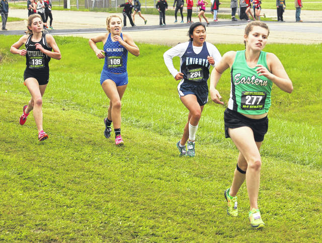 Eastern junior Ally Durst, right, sprints toward the finish line ahead of a pack of runners during the 2017 OHSAA Division III girls cross country championships held Saturday at National Trail Raceway in Hebron, Ohio.