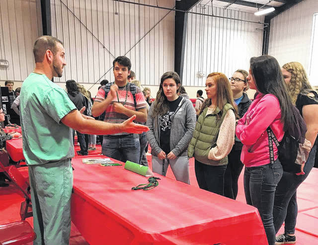 Pleasant Valley Hospital Radiology Technologist Ryan Roush is pictured as he discusses his profession with students at Wahama High School recently. Roush, a Wahama graduate, was one of many from the hospital who attended the school's first on-site career event.