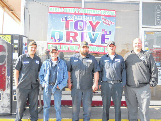 """Pictured are Justin Mitchell, owner of Mitchell Auto Parts, along with Possum's Muffler and Brake owner Charles """"Possum"""" Spencer and his workers Brian Fetty, Robbie Spencer, and Brady Whitt. Mitchell and Spencer have joined forces to collect toys for local kids."""
