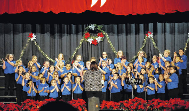 The New Haven Elementary School Choir, under the direction of Kimberly Bond, was one of several groups performing Sunday afternoon at the Bend Area C.A.R.E. Christmas Concert at Wahama High School. The benefit concert netted over $1,000, which will go to the Bend Area C.A.R.E. organization to provide holiday gifts and food to less fortunate children.