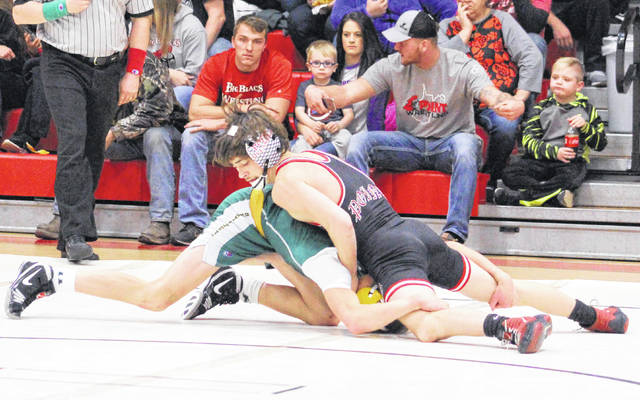 Point Pleasant sophomore Justin Cornell locks in a hold during a 106-pound match against Huntington held on Dec. 6 at Point Pleasant High School.