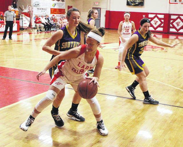 Wahama sophomore Gracie VanMeter dribbles around a Southern defender during the first half of Thursday night's TVC Hocking girls basketball contest in Mason, W.Va.