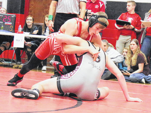 Wahama junior Ethan VanMatre locks in a hold during a 120-pound match against a George Washington opponent at the 2017 Jason Eades Memorial Duals held on Dec. 8 in Point Pleasant, W.Va.
