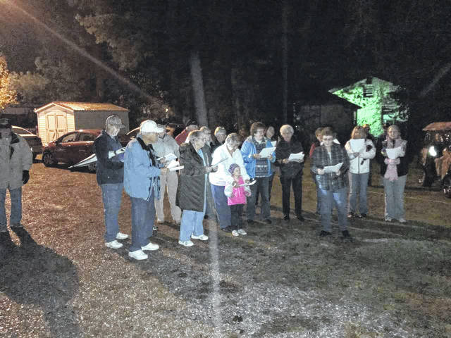Members of the Faith Baptist Church Choir were on hand at the lighting of the Mason town Christmas tree Thursday evening. The group sang carols, with the crowd joining in. Afterwards, popcorn and hot chocolate were served by town employees.