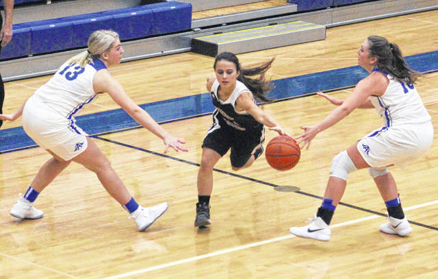 Point Pleasant junior Hannah Smith, middle, splits a pair of Gallia Academy defenders during the first quarter of Thursday night's non-conference girls basketball game in Centenary, Ohio.