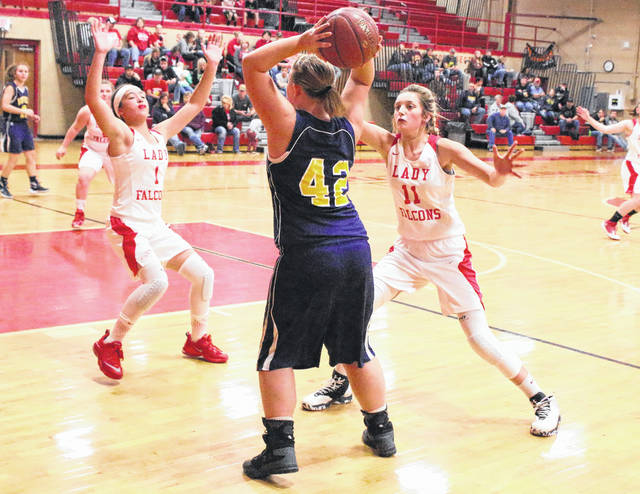 Wahama defenders Hannah Rose (1) and Emma Gibbs (11) apply pressure to Buffalo's Alexys Spaulding (42) during the second half of Friday night's girls basketball contest at Gary Clark Court in Mason, W.Va.