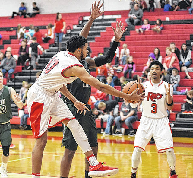 Rio Grande's Devon Price attempts a wrap-around pass to teammate Stanley Christian during Tuesday afternoon's 91-70 win over Ohio University-Lancaster in the 5th Annual Champions of Character Classic at the Newt Oliver Arena. The RedStorm improved to 6-9 with the victory.
