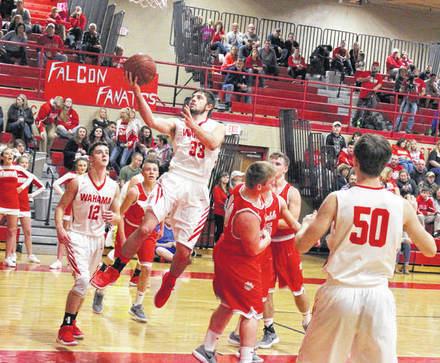 Wahama senior Noah Litchfield (33) releases a shot attempt during the second half of Tuesday night's TVC Hocking boys basketball contest against Trimble in Mason, W.Va.