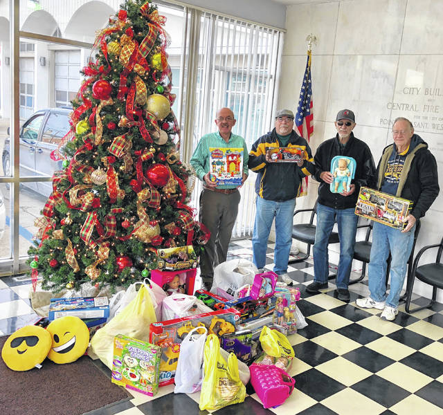 Moose Lodge #731 recently donated to Mason County Toys for Kids. Pictured with the collected toys are Mayor Brian Billings, Bill Tillis, Dale Smith and Brice Gilpin.
