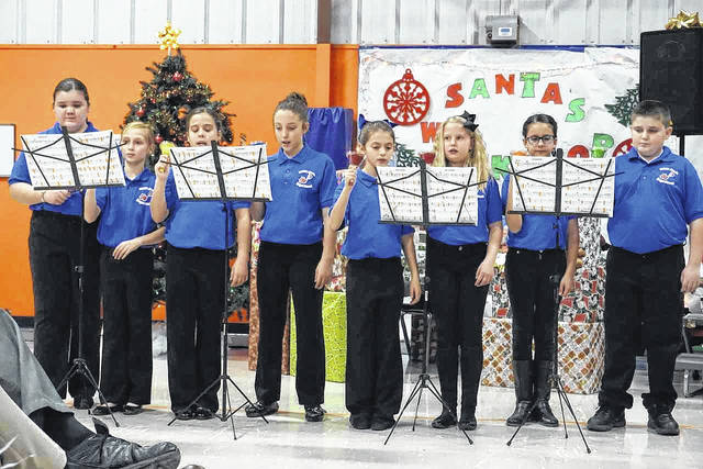 "The New Haven Elementary Chorus, directed by Kimberly Bond, presented a Christmas concert Tuesday evening at the school. One selection, ""Hark, Hear the Bells,"" featured bell ringers Lillian Bowles, Mary Claire Brinker, Katie Cullen, Carson Gibbs, Raegan Johnson, Anna Bella Mankin, Kate Reynolds and Phoebe Richardson."