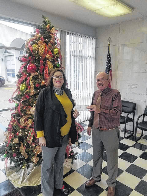 Point Pleasant Rotary recently donated $1,000 to Mason County Toys for Kids. Pictured are Julia Schultz, Point Pleasant Rotary president and Mayor Brian Billings from Toys for Kids. All proceeds were collected through the Rotary's annual bell ringing project.
