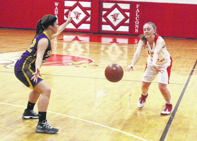 Wahama senior Elizabeth Mullins throws a bounce pass into the paint area during the second half of a Dec. 14 TVC Hocking girls basketball contest against Southern in Mason, W.Va.