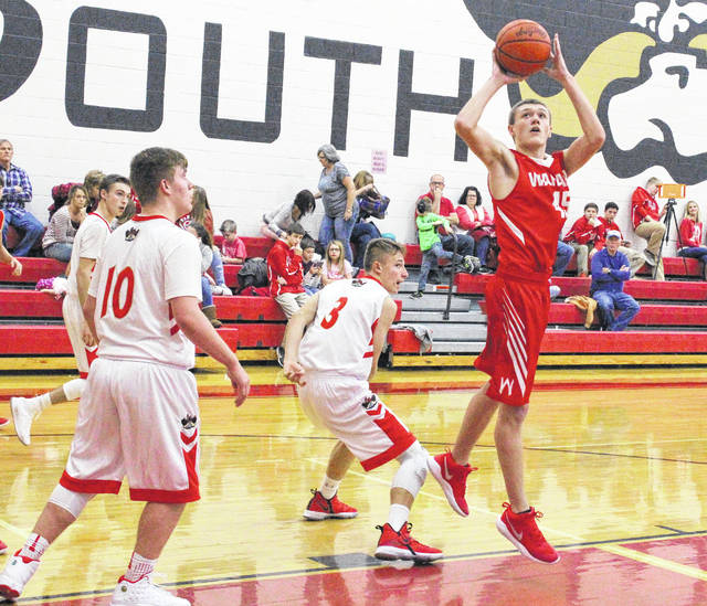 Wahama junior Dakota Belcher, right, releases a shot attempt over a South Gallia defender during the first half of Friday night's TVC Hocking boys basketball contest in Mercerville, Ohio.