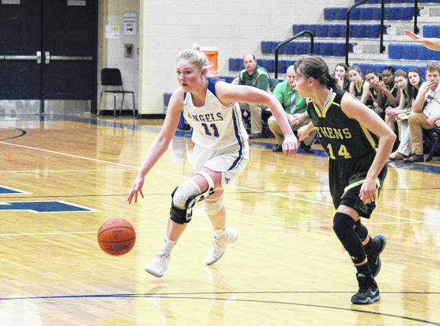 Gallia Academy junior Ashton Webb (11) drives past Athens sophomore Laura Manderick (14), during the second half of the Blue Angels' 58-43 win on Saturday in Centenary, Ohio.