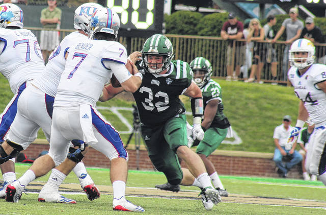 Ohio senior Quentin Poling (32) gets to the Kansas quarterback, during the Bobcats' non-conference win on Sept. 16 in Athens, Ohio.