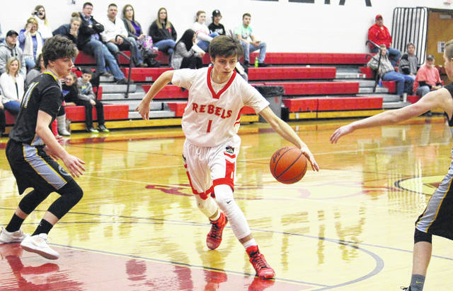 South Gallia's Braxton Hardy (1) drives through the OVCS defense, during the second half of the Rebels' 83-27 victory on Friday in Mercerville, Ohio.