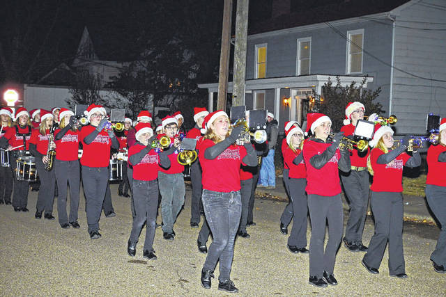 Members of the Point Pleasant Junior High School Marching Band get in the holiday spirit by performing in the annual Christmas Parade in Point Pleasant. More photos from Friday's parade appear inside this edition and online at www.mydailyregister.com.