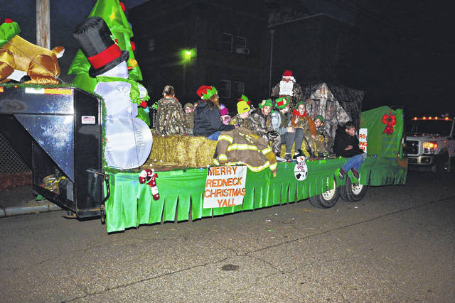 Participating in the Point Pleasant Christmas Parade are members of the Mountaineers 4-H Club, celebrating a redneck Christmas.