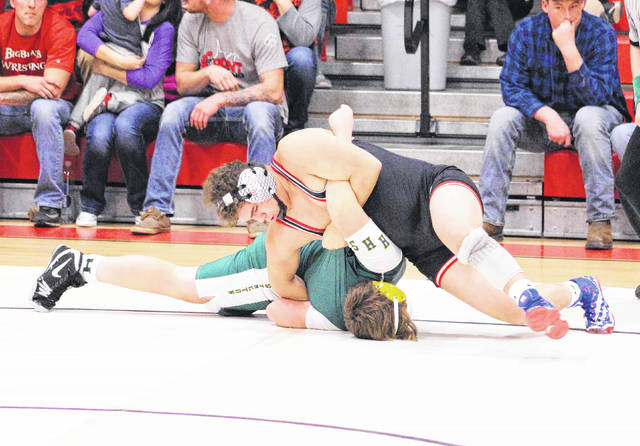 Point Pleasant sophomore Juan Marquez locks in a hold during a 220-pound match against Huntington on Wednesday night in Point Pleasant, W.Va.