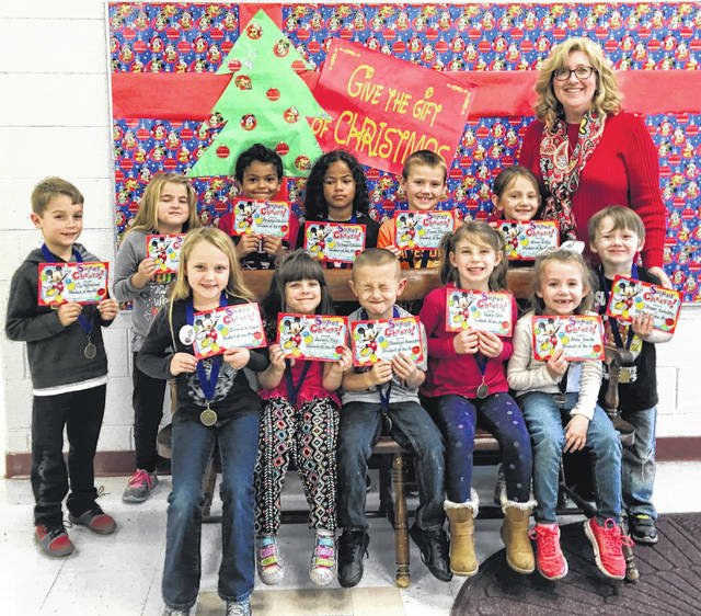 November Students of the Month were recently announced for Point Pleasant Primary School. The students were recognized by their classroom teacher and ate lunch with their principal, Vickie Workman. Pictured with Workman are Cy Watterson, Emma Gibbs, Tyshawn Clendenin, Brandson Bonecutter, Trevor Schultz, Braxton Clendenin, Olivia Ott, Jealeen Kay, Alivia Smith, Allie Allen, Izabella Gillispie, Isaac Stephens.