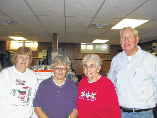 Clothes and food pantry volunteers Genia Williams, Donna Lambert, Pam Lambert, and George Dowell.