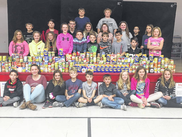 Roosevelt elementary sixth grade students with their cans.