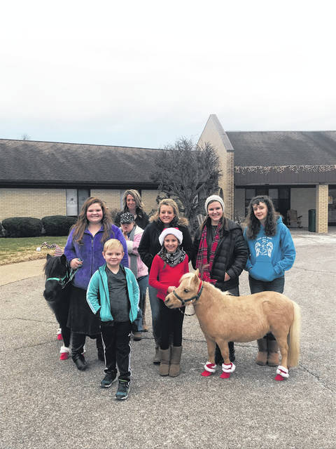 The Cowboys & Angels 4-H group visited the Pleasant Valley Nursing and Rehabilitation Center on Sunday Dec. 17. They shared their Christmas cheer by singing carols and taking the mini horses around to visit